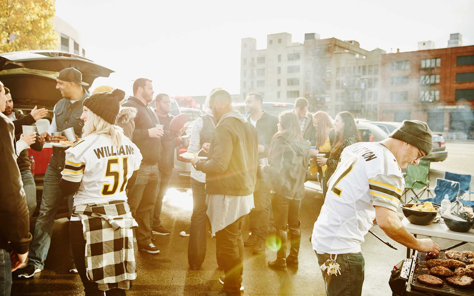 Friends tailgating before a football game