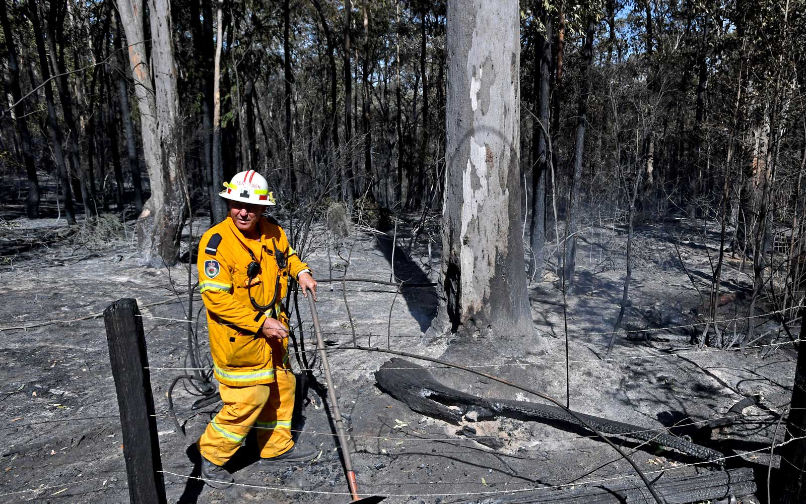 A Rural Fire Service (RFS) firefighter walks through the perimeter of an extinguished blaze in the township of East Kurrajong, on October 26, 2019 near Sydney, Australia.