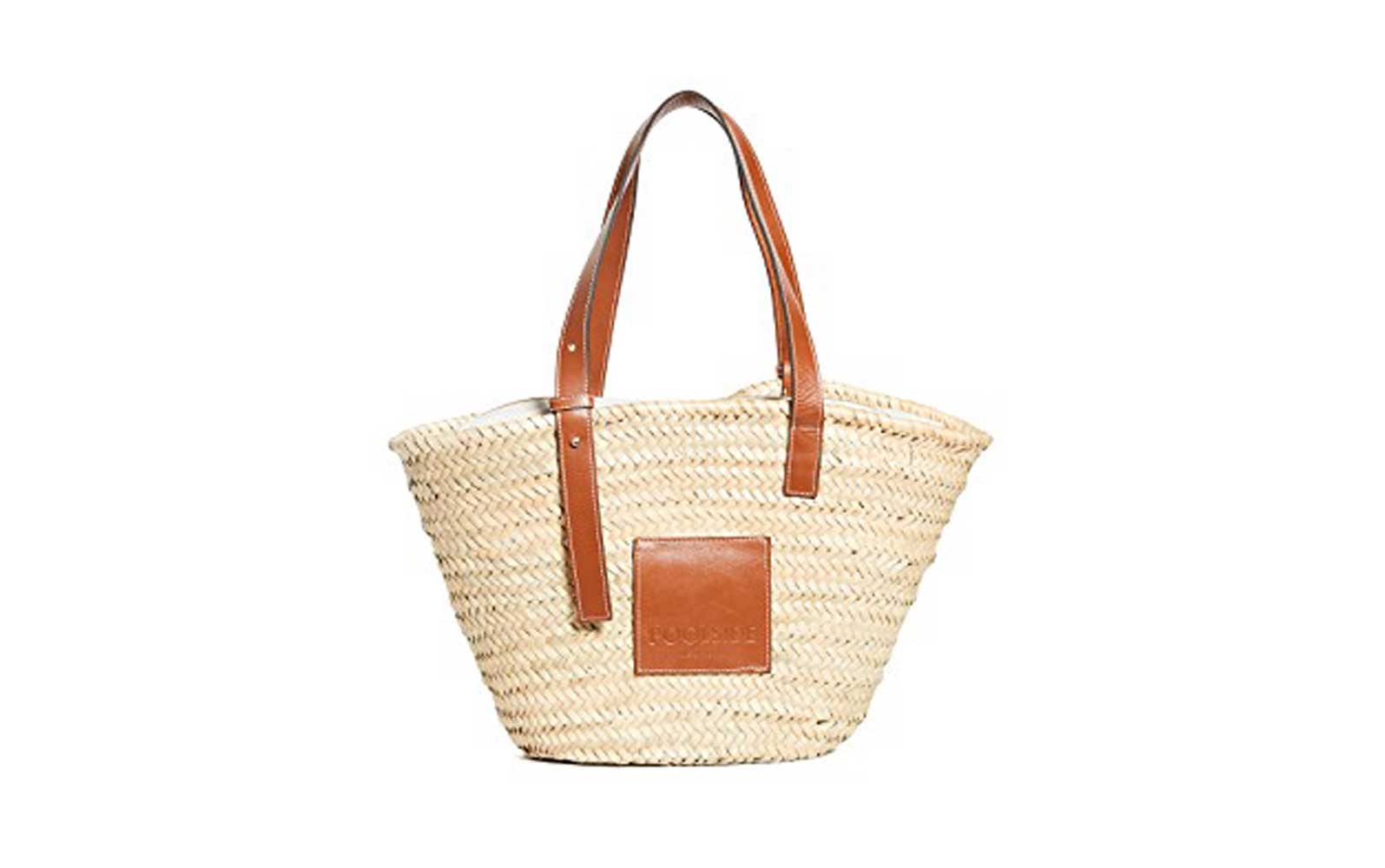 beige woven tote with light brown leather shoulder strap and accents