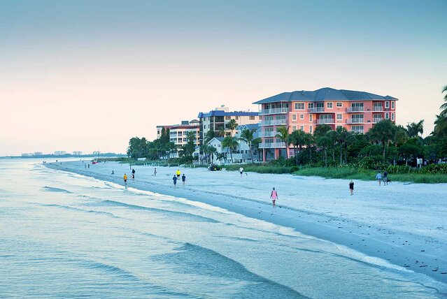Sunrise brings beach walkers to Fort Myers Beach located on Estero Island along the Gulf of Mexico.
