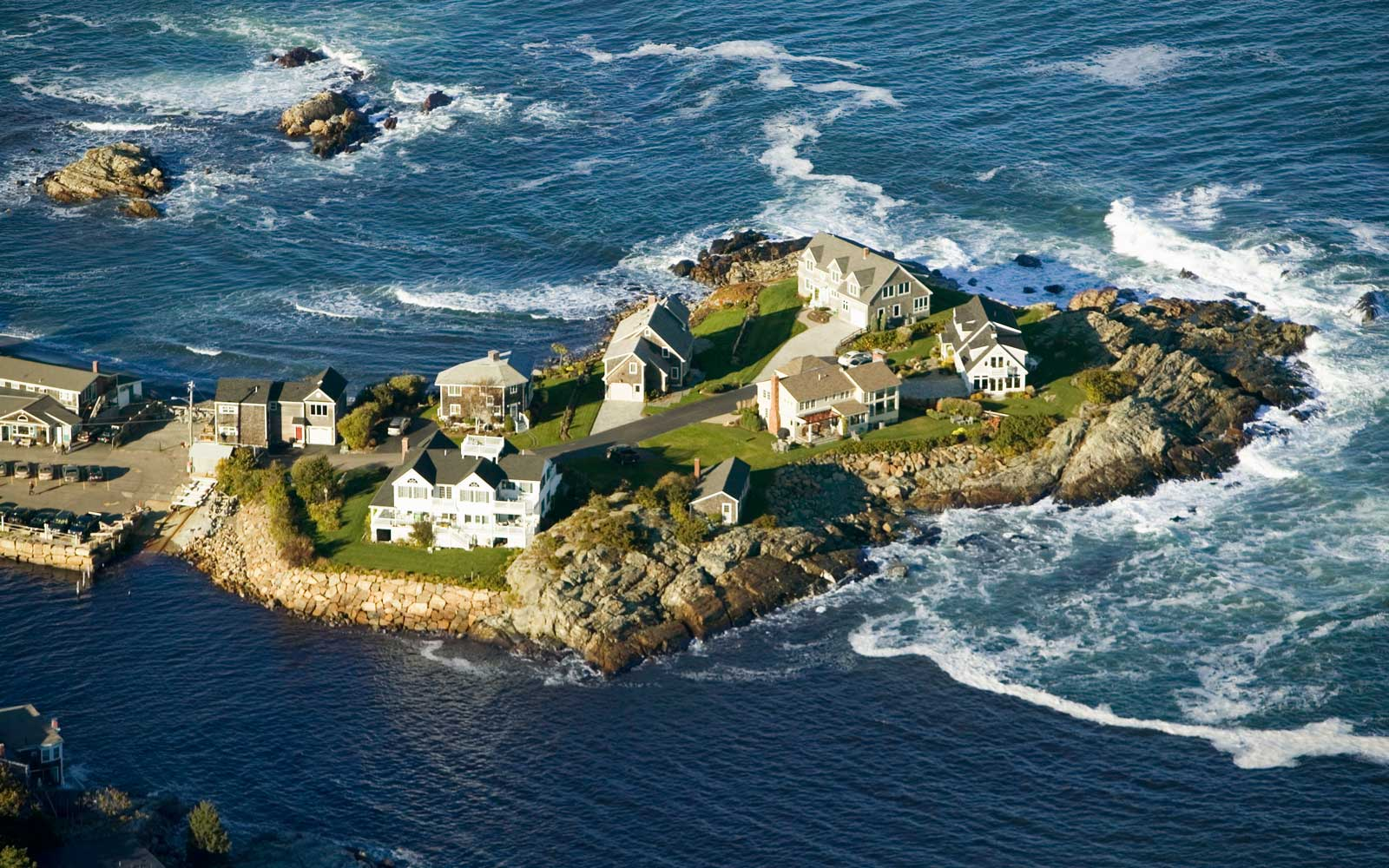 Aerial view of ocean-front homes on Perkins Cove, on coast of Maine south of Portland