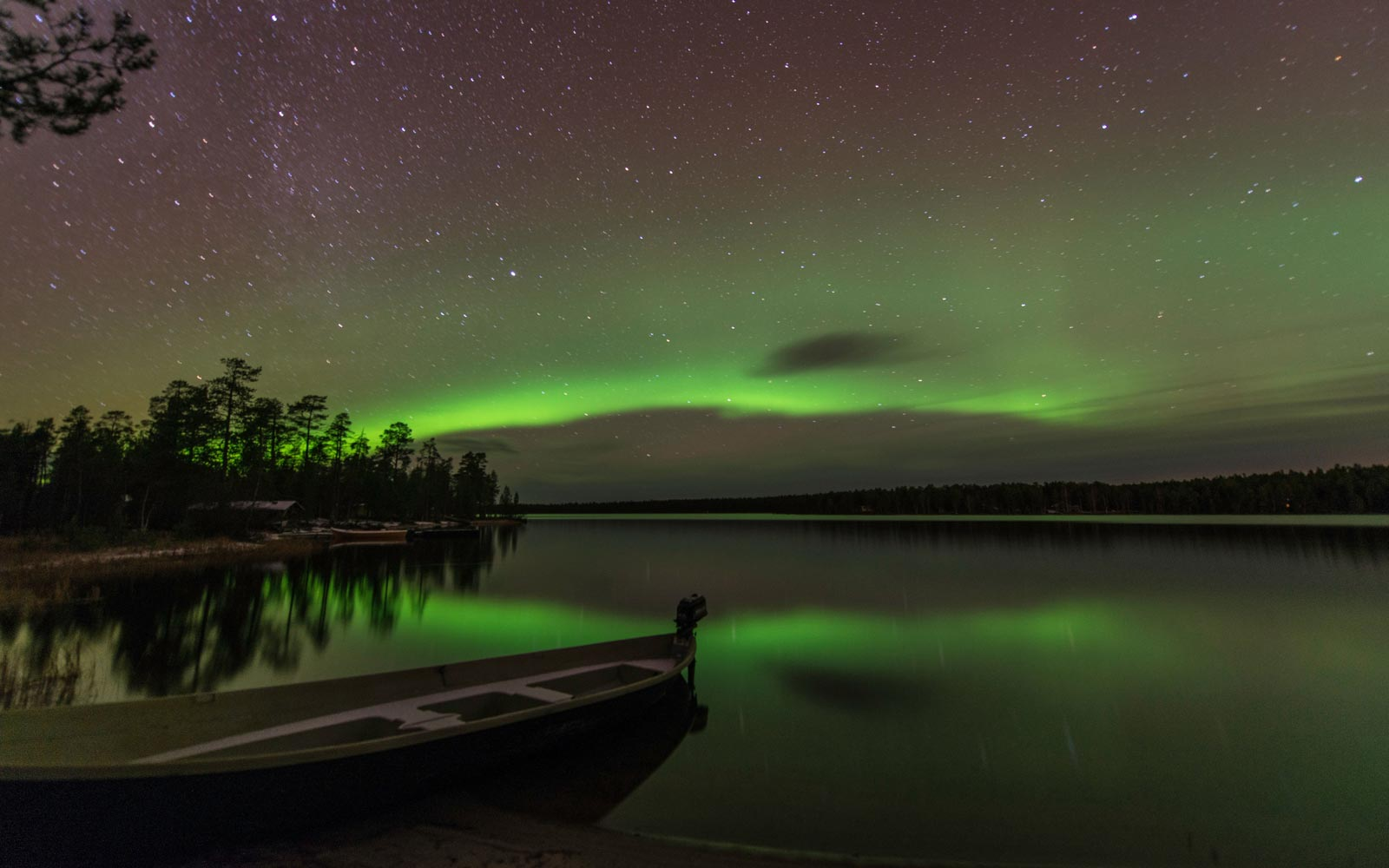 Northern light or Aurora Borealis Nellim near Inari Lake in Lapland, Finland