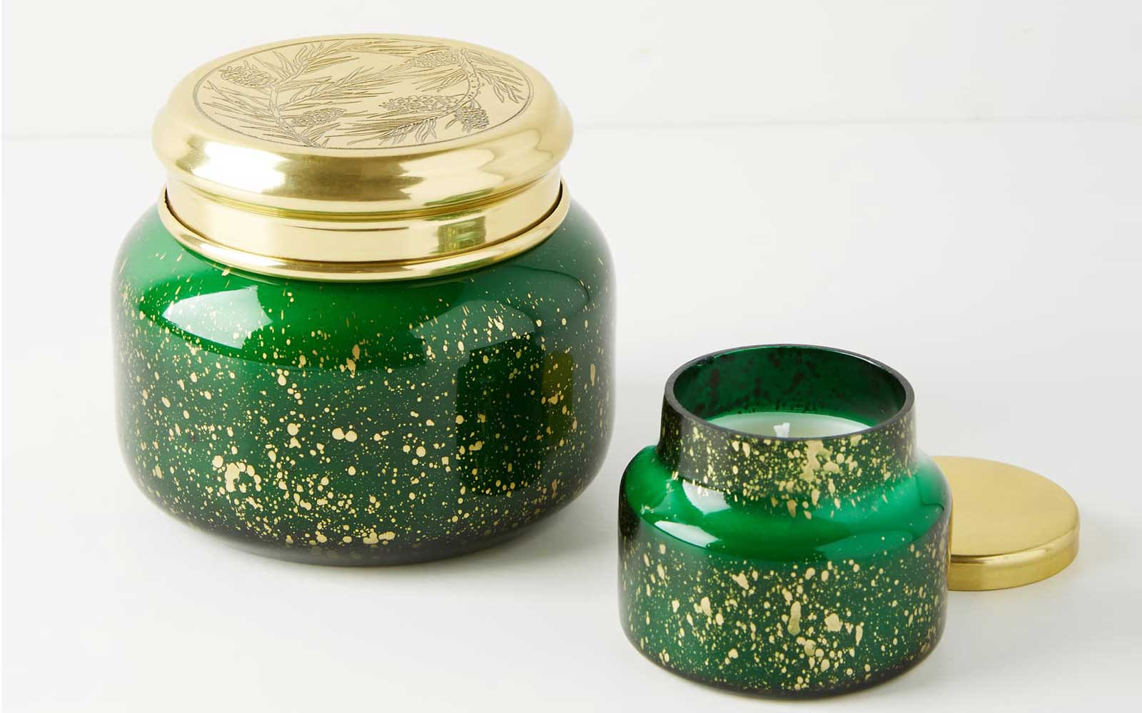Green and Gold Candles in Glass Jars