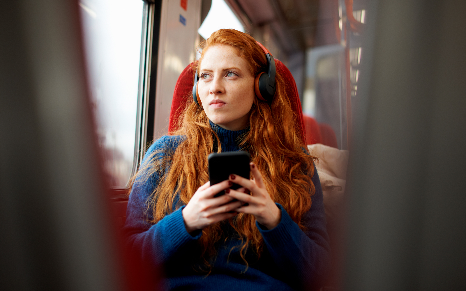Woman traveling with headphones