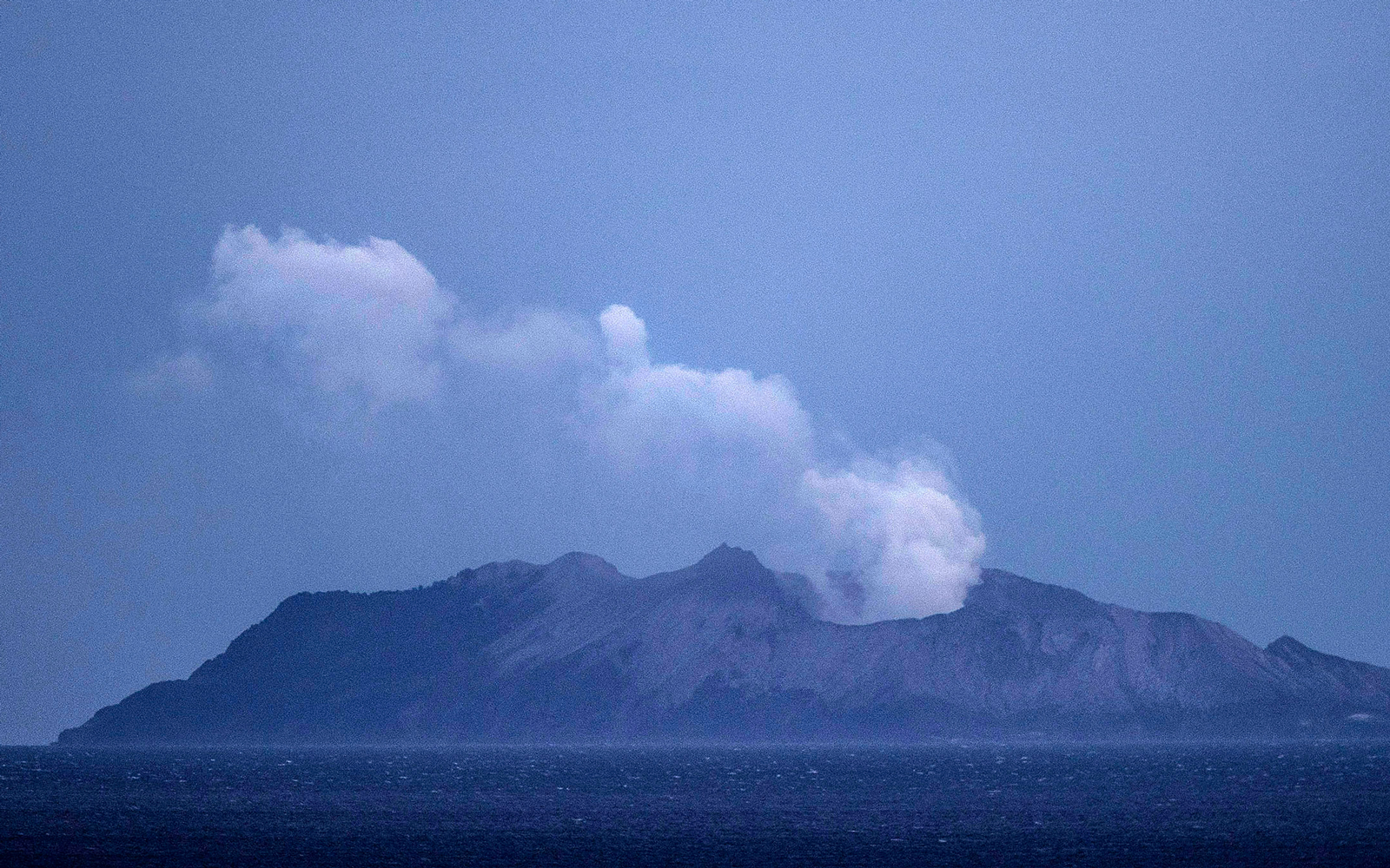 Smoke and ash rises from a volcano on White Island