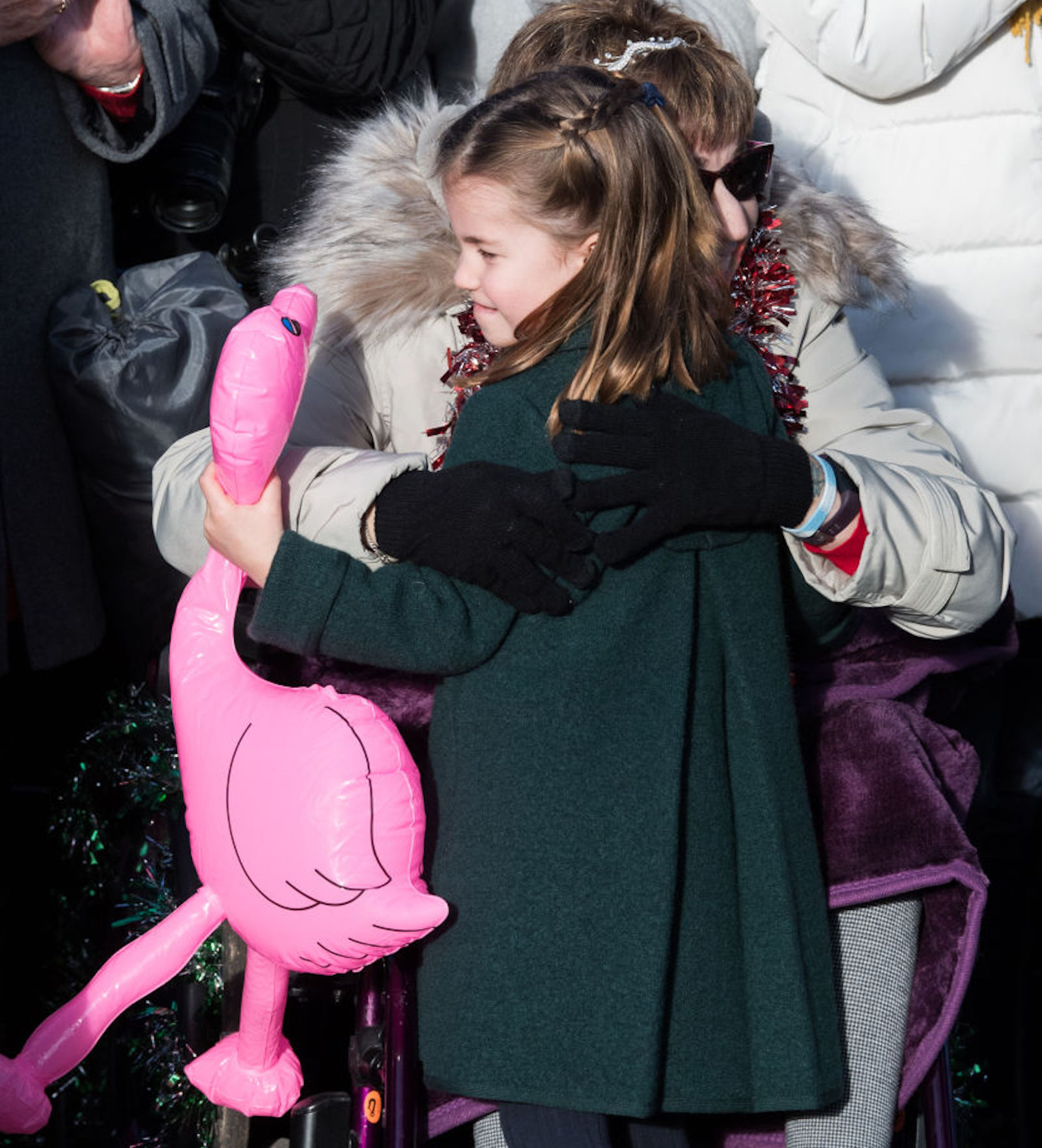 Princess Charlotte of Cambridge is given a hug by a wellwisher as she attends the Christmas Day Church service at Church of St Mary Magdalene