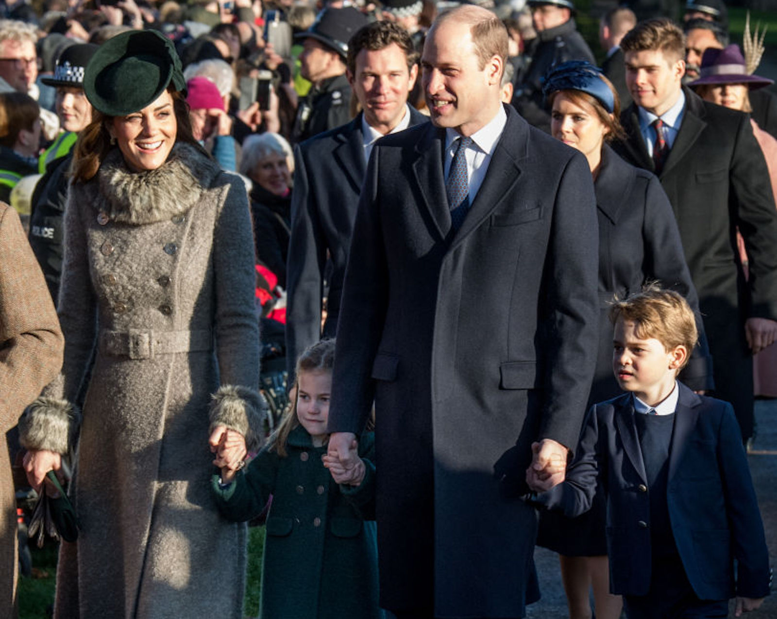 Prince William, Duke of Cambridge and Catherine, Duchess of Cambridge with Prince George of Cambridge and Princess Charlotte of Cambridge attend the Christmas Day Church service at Church of St Mary Magdalene