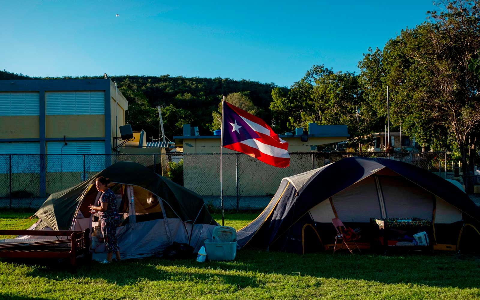Solmely Velazquez stands in front of her tent in a baseball field in Guanica, Puerto Rico on January 15, 2020, after a powerful earthquake hit the island.