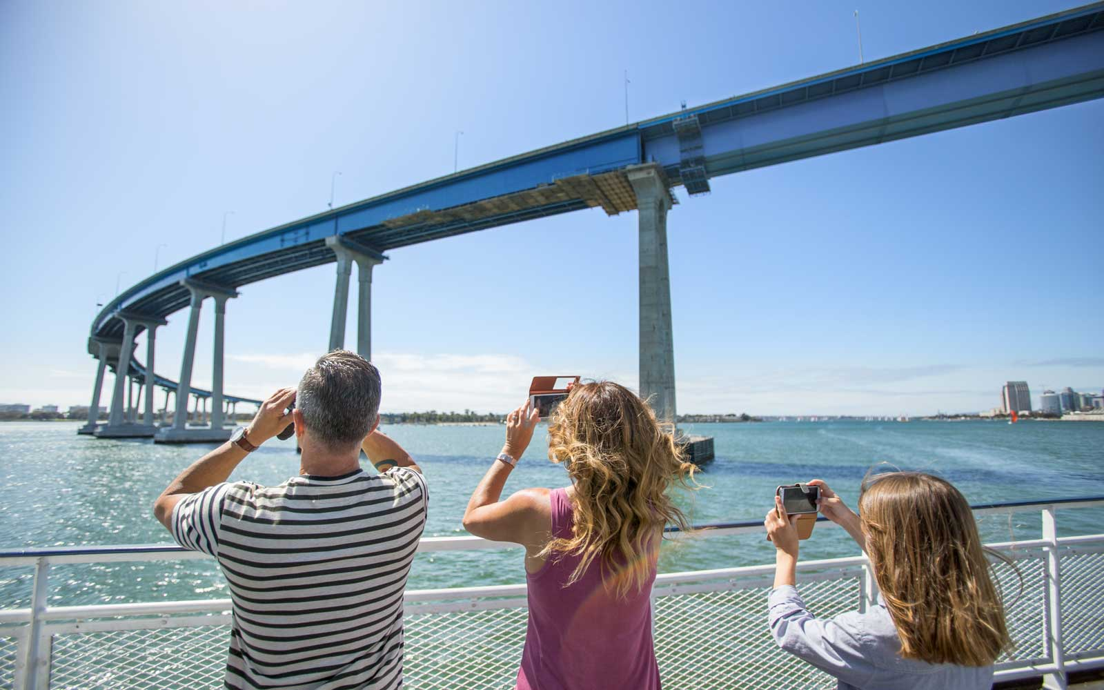 Tourists on Hornblower cruise in San Diego near Coronado bridge