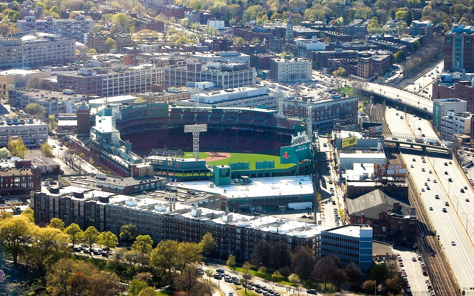 A view of Fenway Park in Boston with surroundings.  Shot from above.