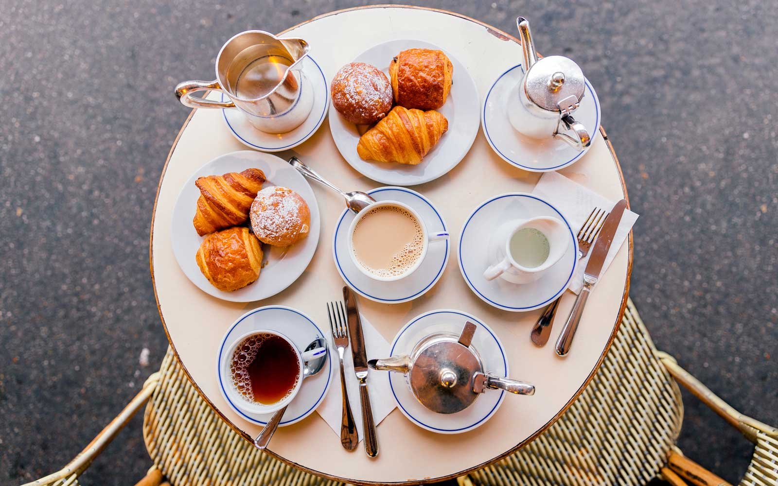 Fresh croissants, coffee and tea in French cafe, Paris, France