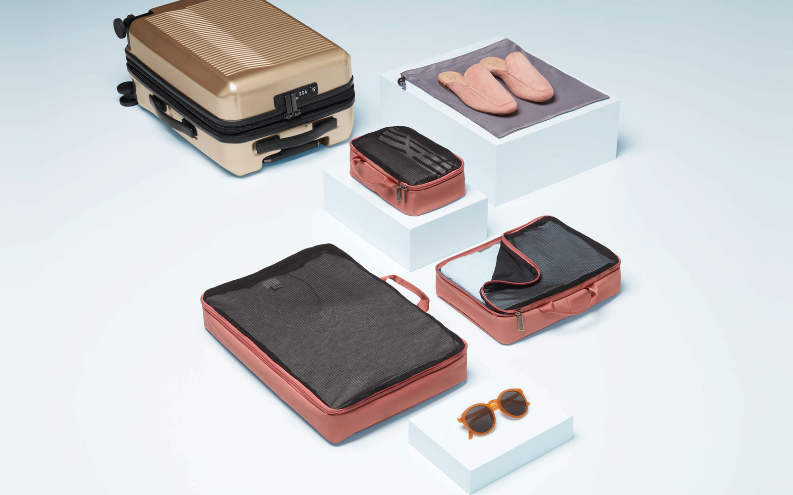 Collection of Target Luggage and Packing Cubes