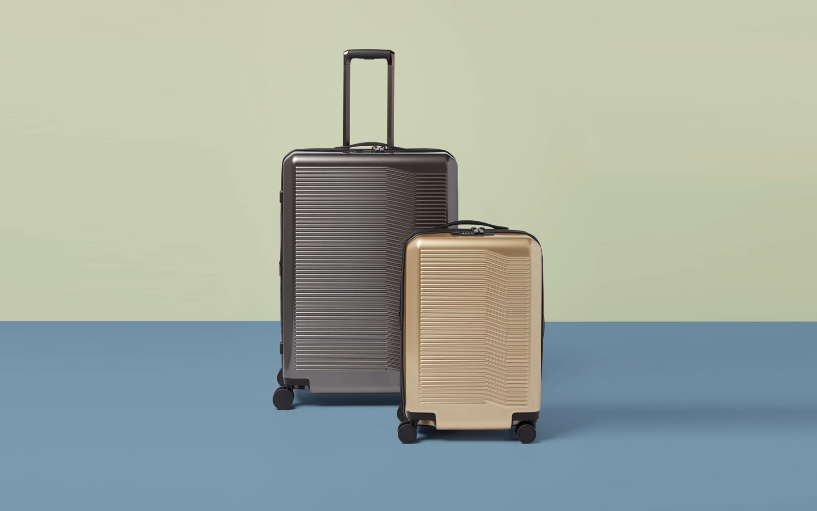 Small Gold and Large Silver/Grey Suitcases