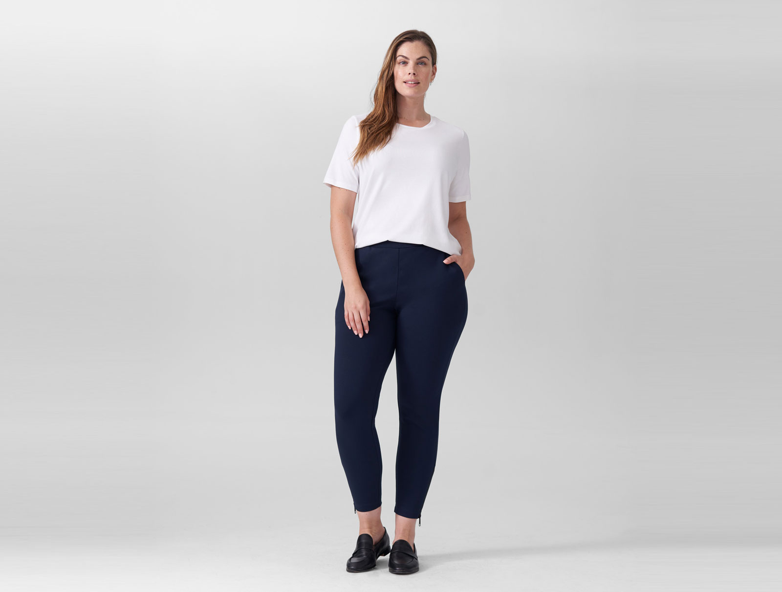 Woman wearing navy skinny pants