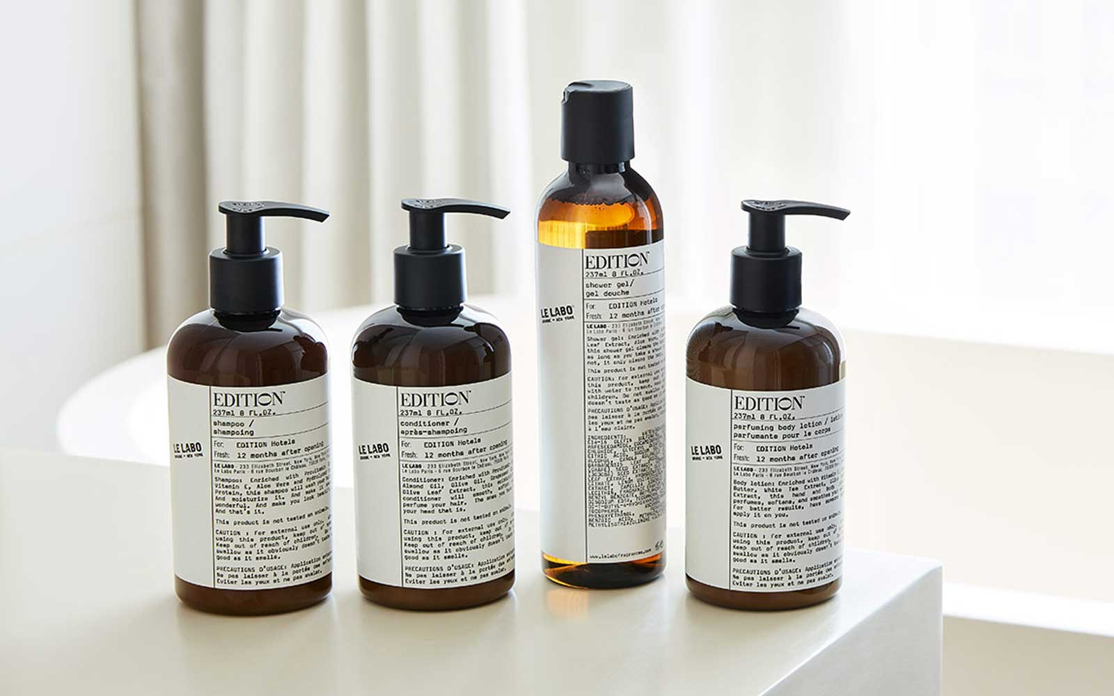 Le Labo Bath & Body Set including shampoo, conditioner, shower gel, and body lotion bottles