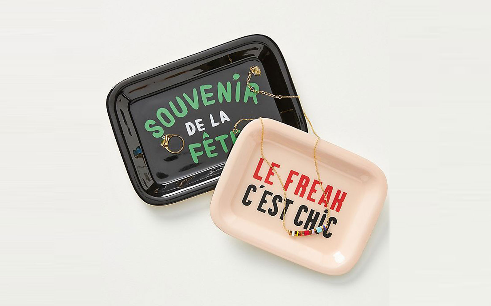Multi-colored trays with French phrases