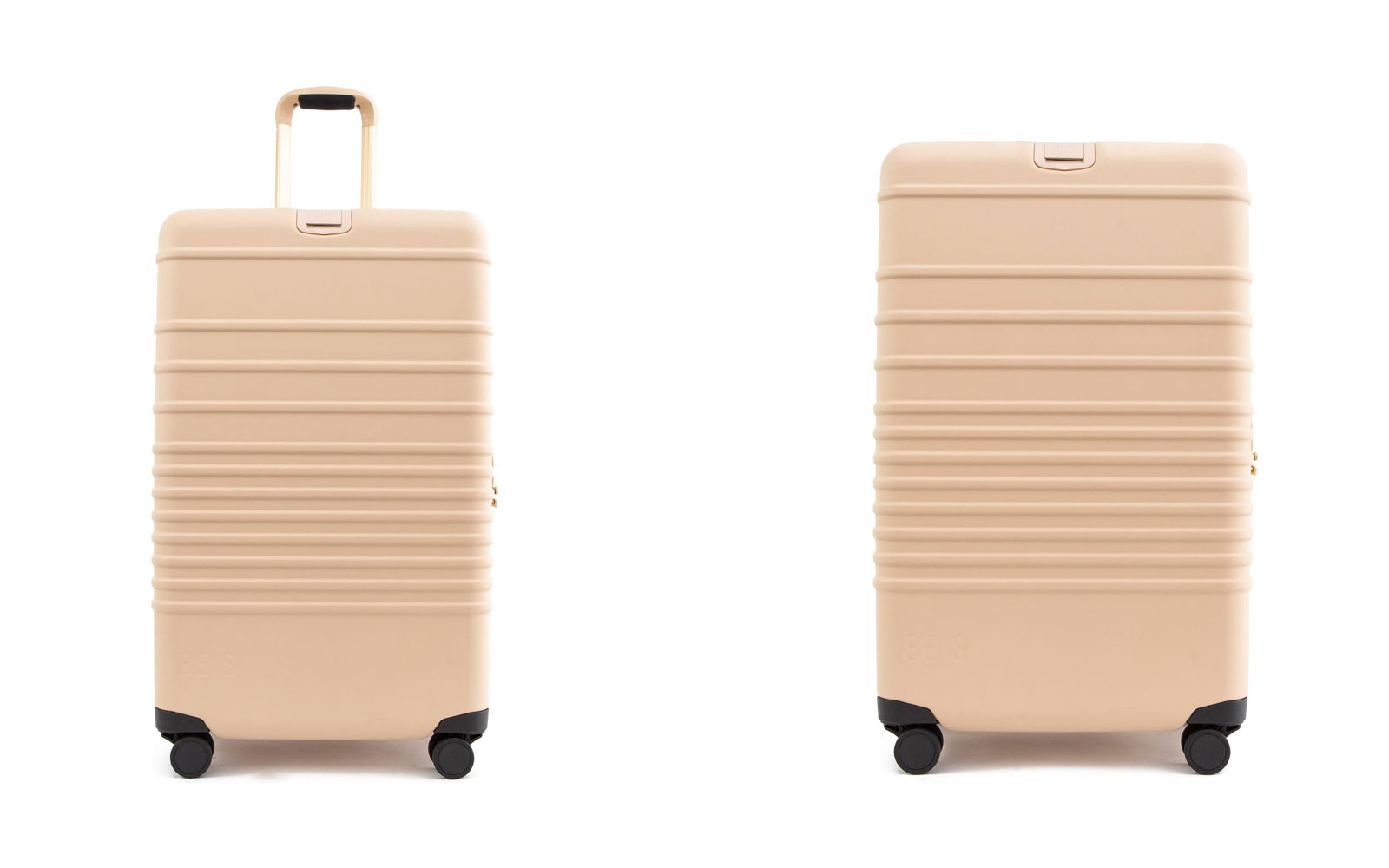 Two beige Hardside suitcases