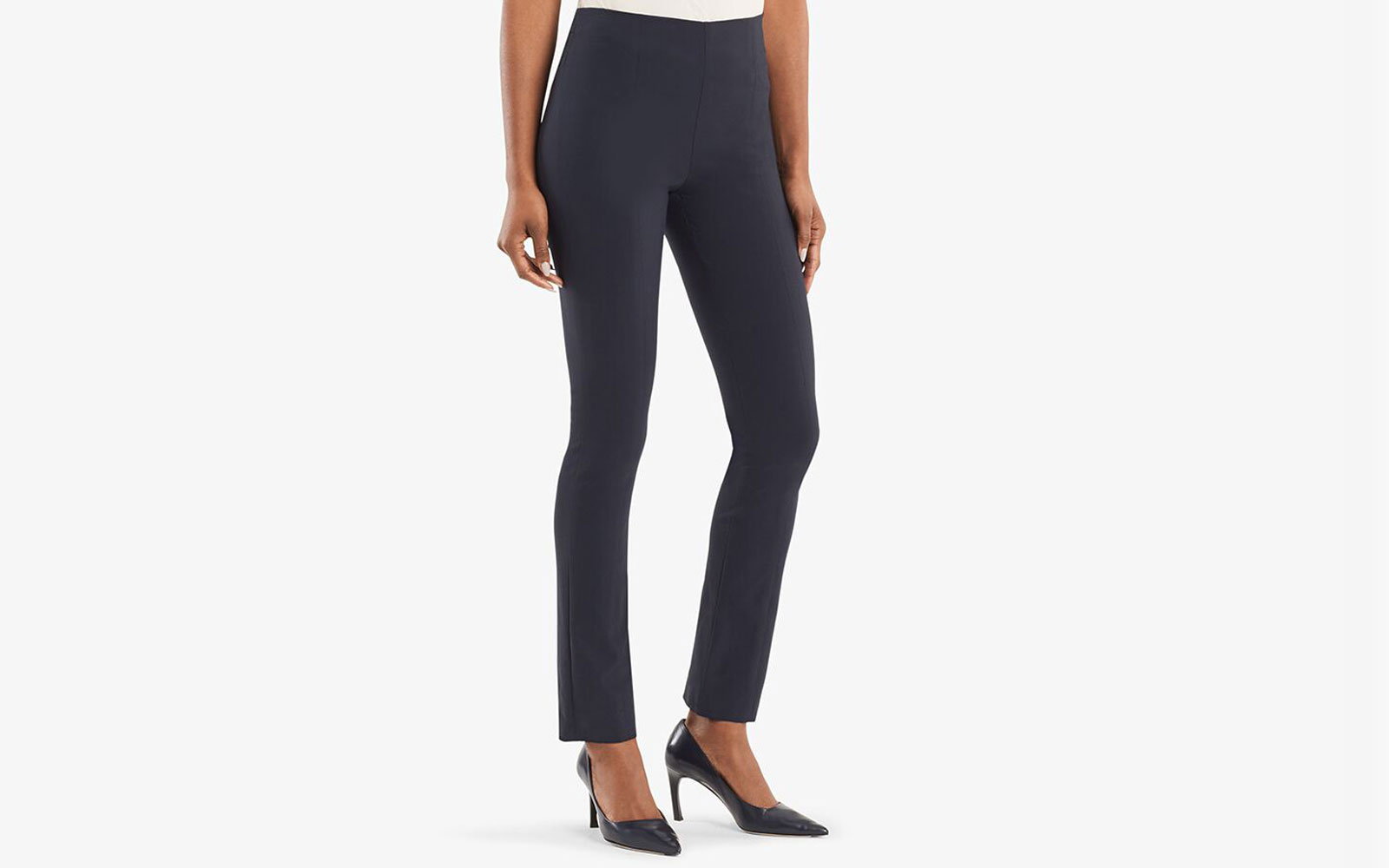 Woman wearing navy ankle length work pants