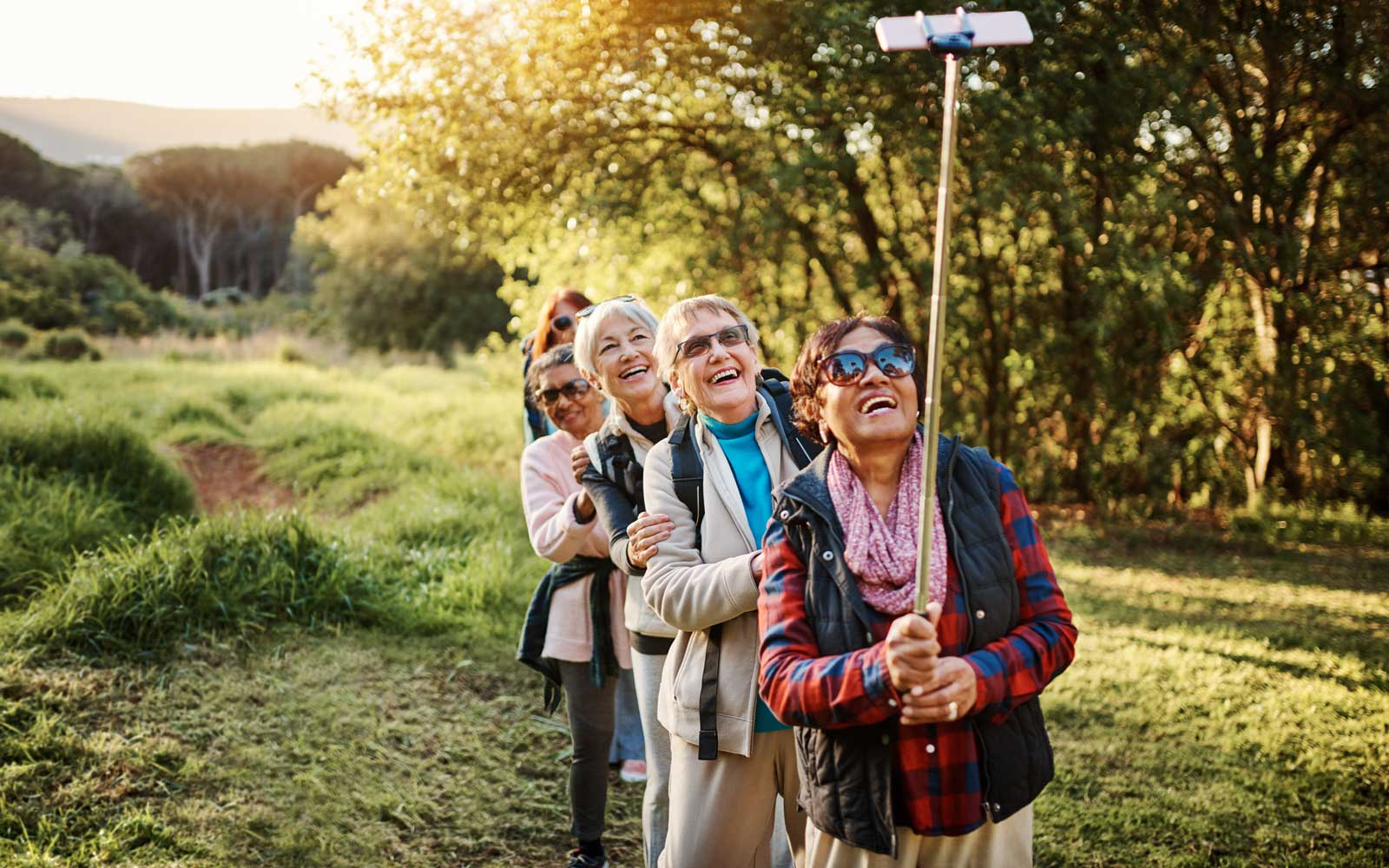 Happy senior women taking selfies during a hike in the great outdoors