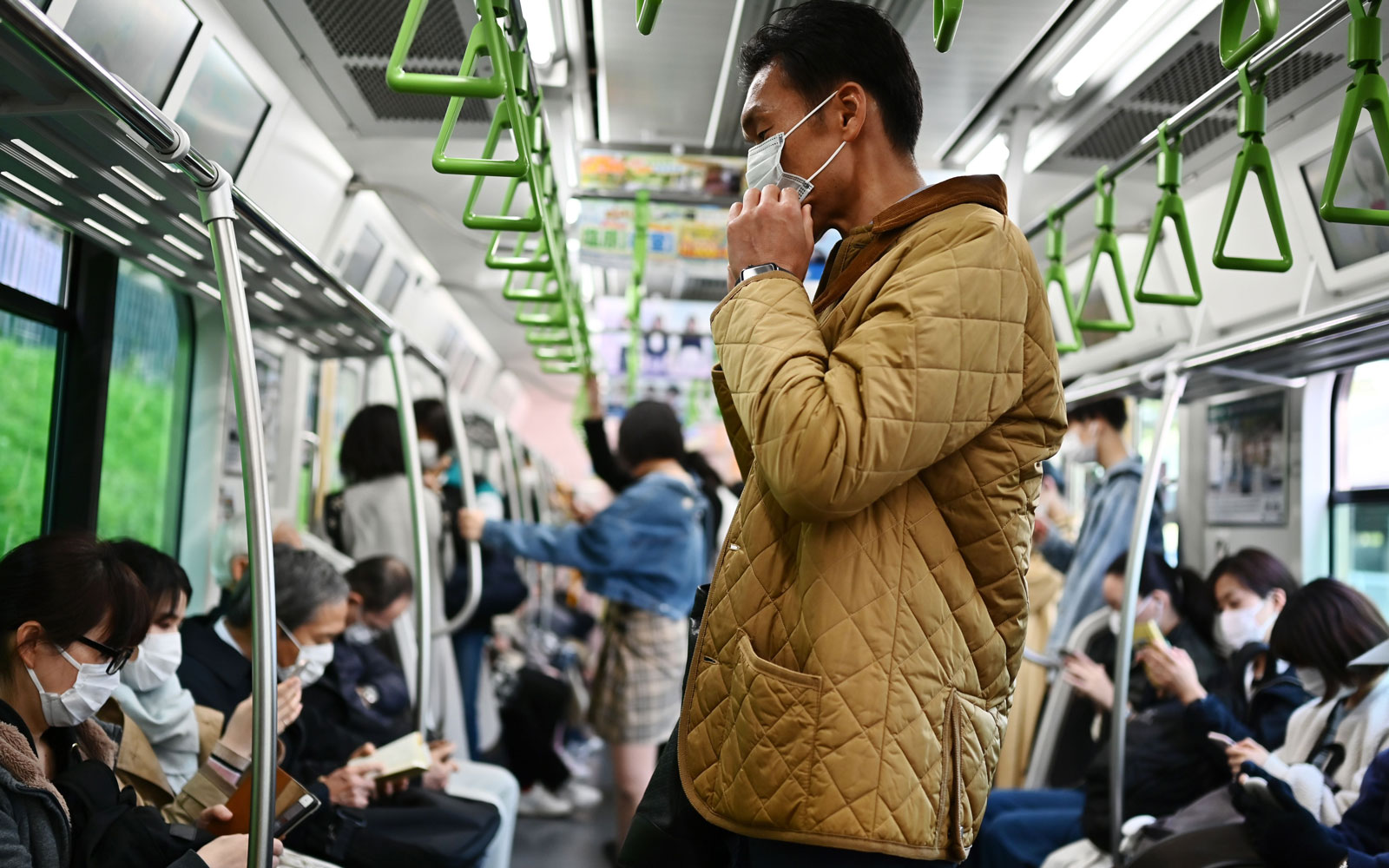 man travelling on the metro train in Tokyo