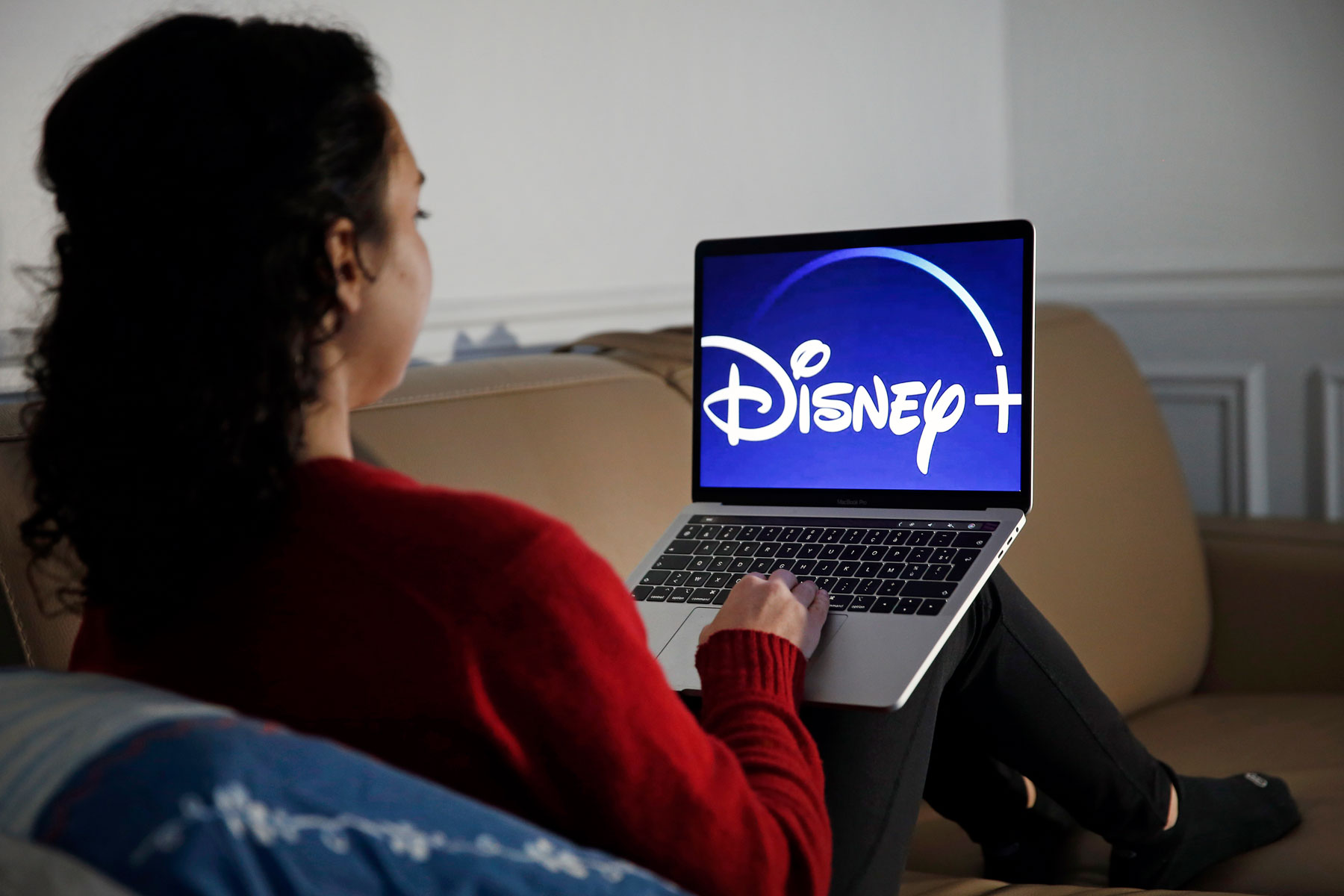 woman watching Disney+