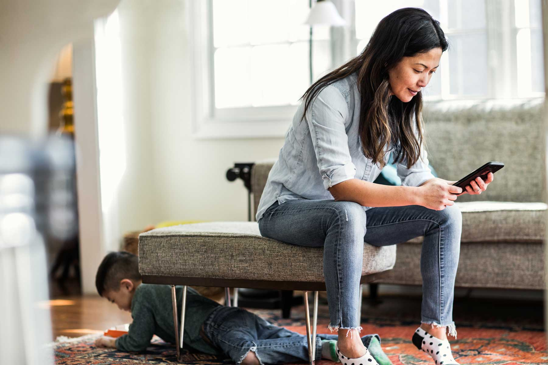 Woman using smartphone at home