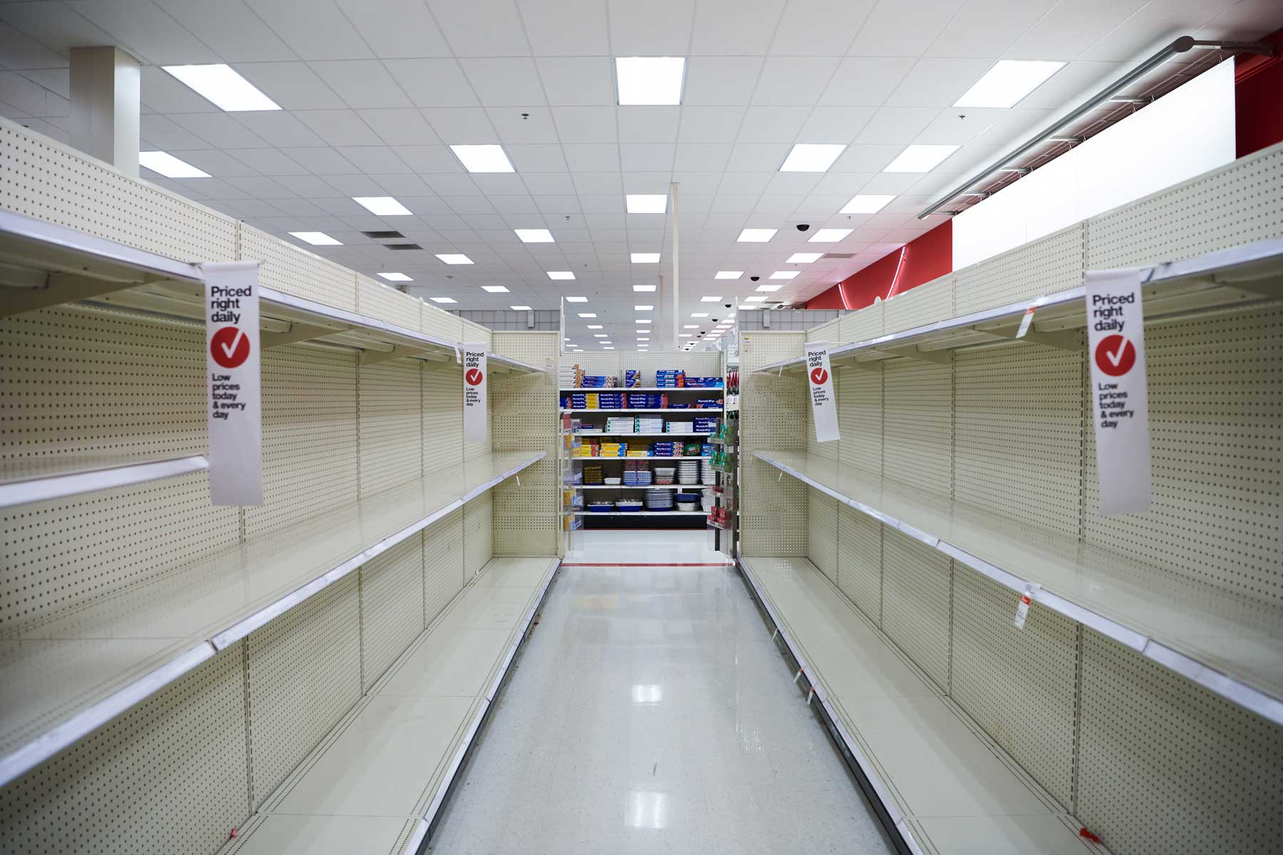 Shelves at the Target department store in Wadsworth, Ohio are empty of supplies such as toilet paper and sanitizer a day after Ohio Governor Mike DeWine put in place a stay-at-home order.