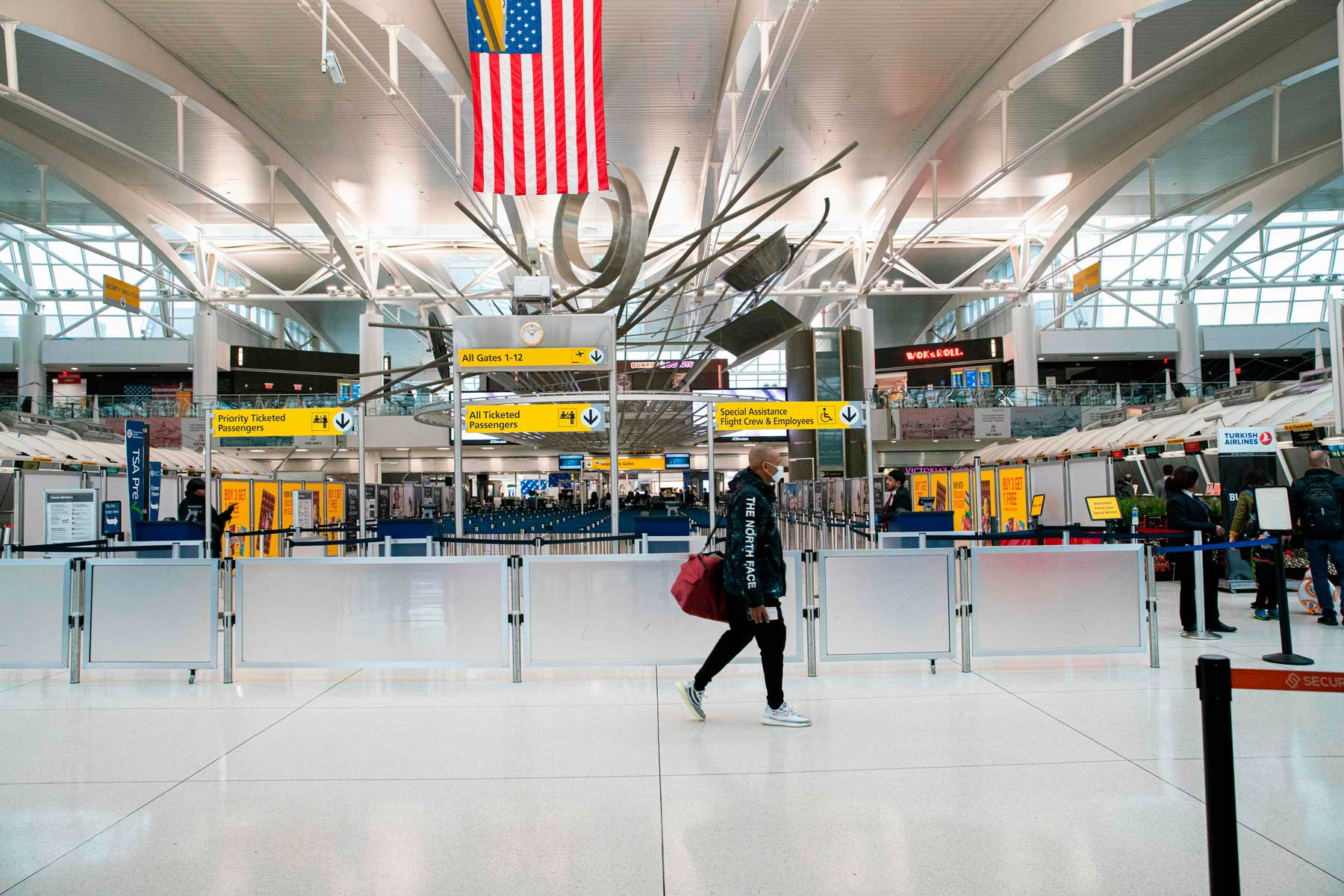 A man walks past counters at the Terminal 1 section at John F. Kennedy International Airport on March 12, 2020 in New York City