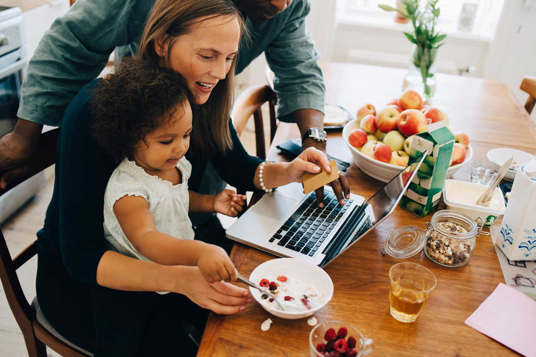 family working and eating