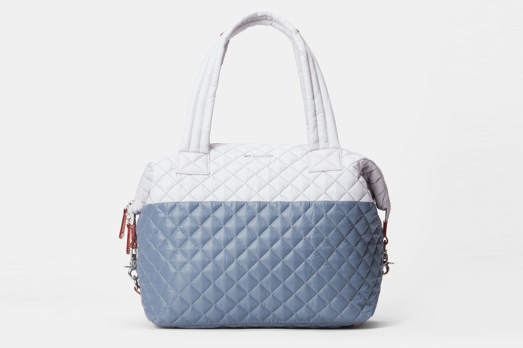 White and blue quilted duffel bag