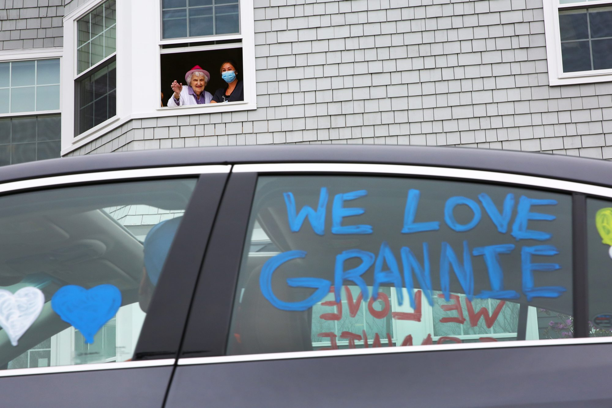 Grandma waves to drive-by birthday