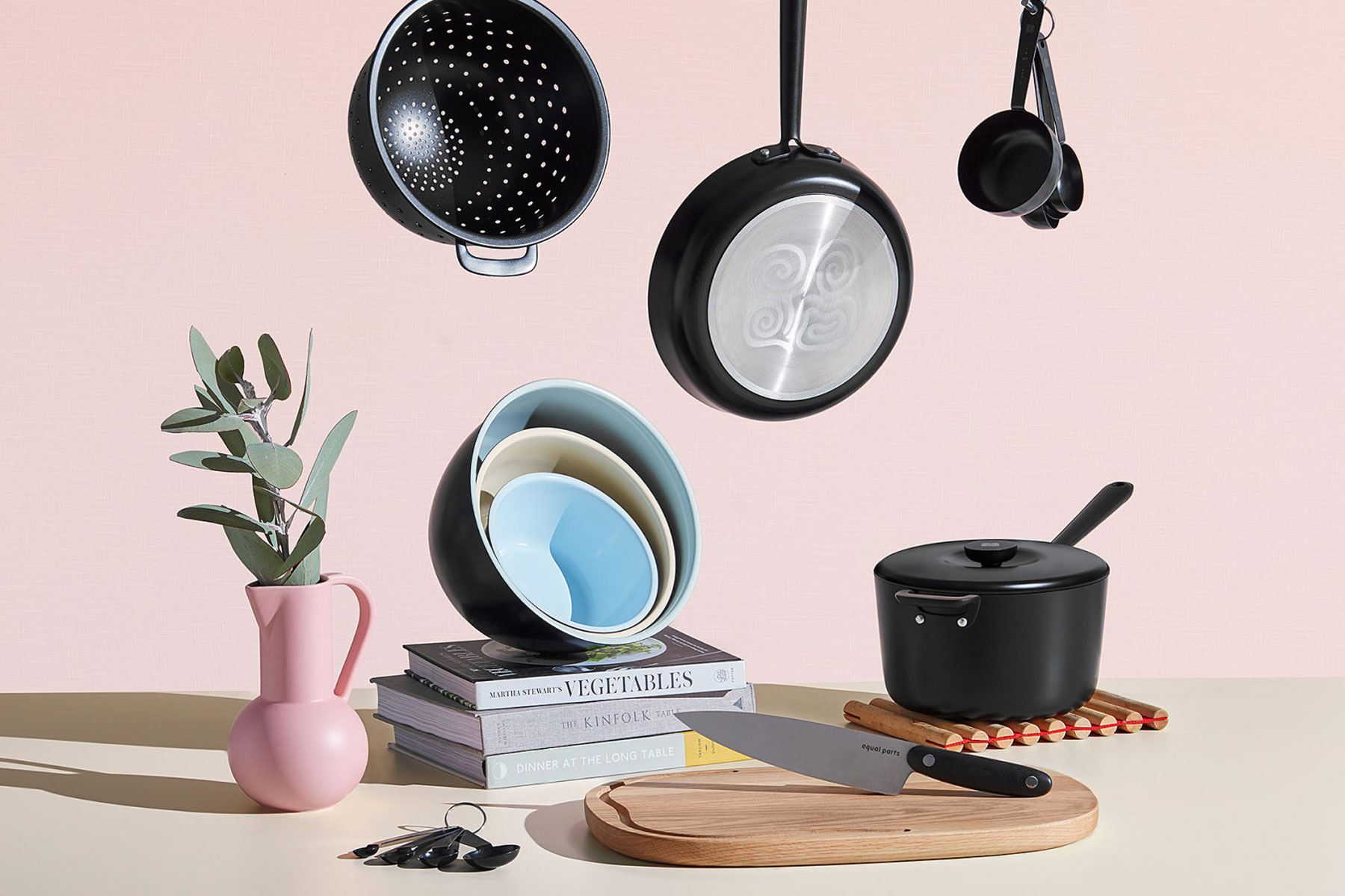 Black and stainless steel cookware set