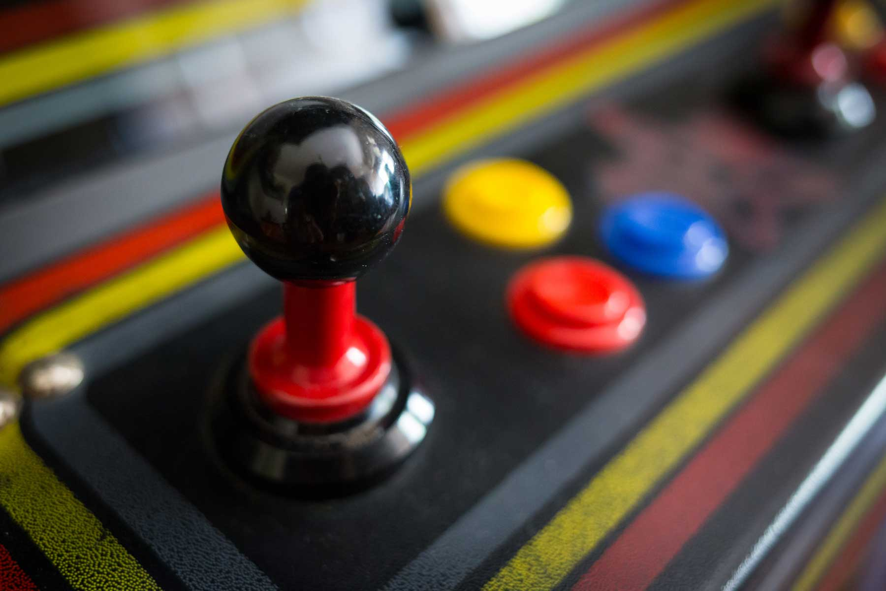 Joystick and button controls of classic coin-operated arcade game