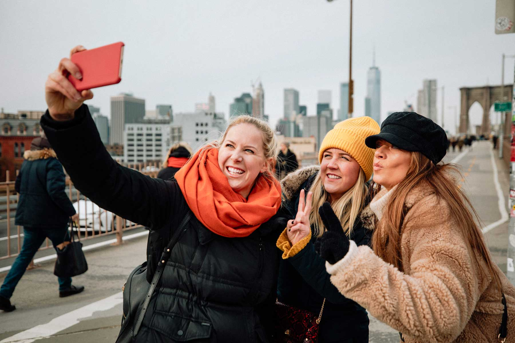 Three women posing for a selfie in New York City during Winter.