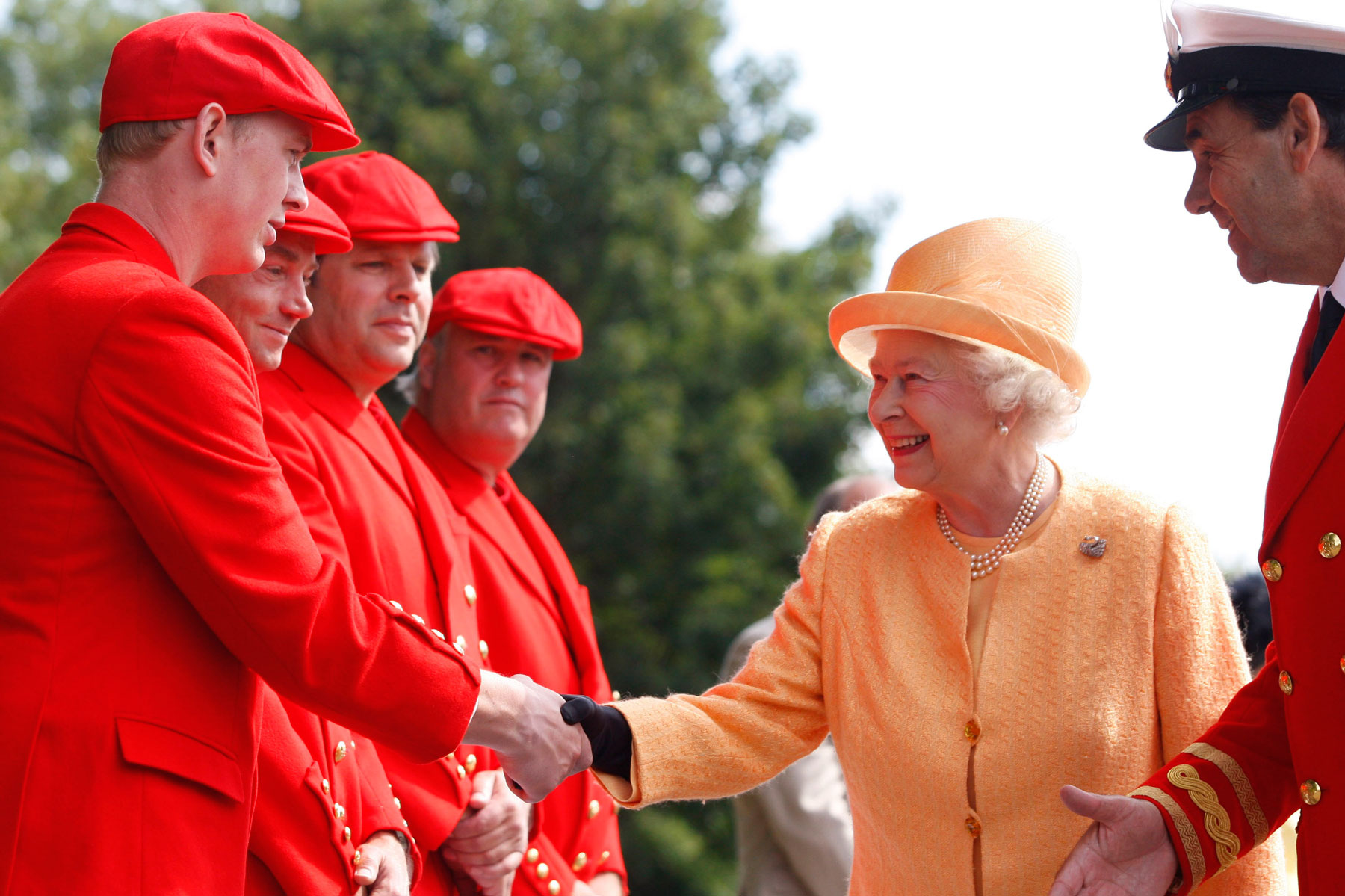 Queen Elizabeth greets a team of Swan Uppers