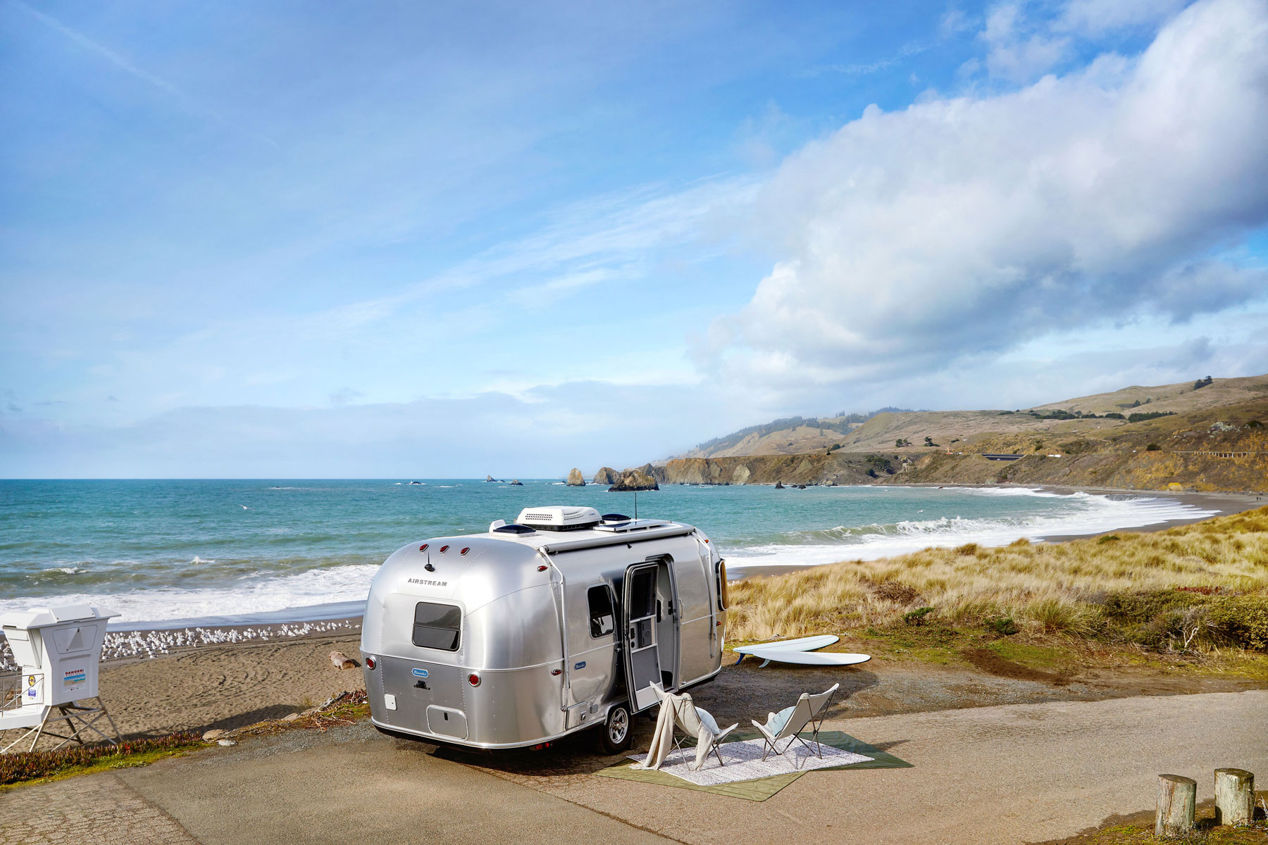 Airstream trailer parked near beach