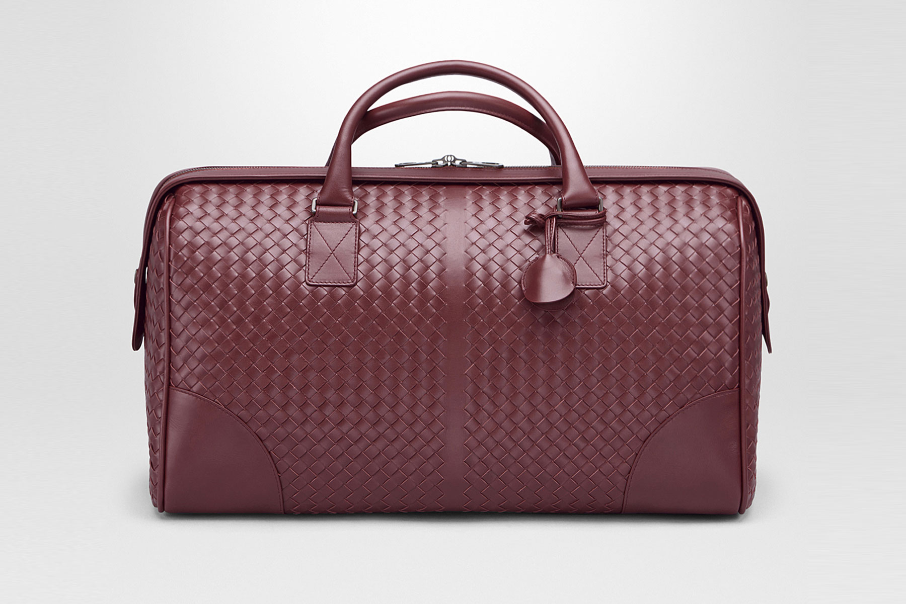 Dark red leather duffel bag