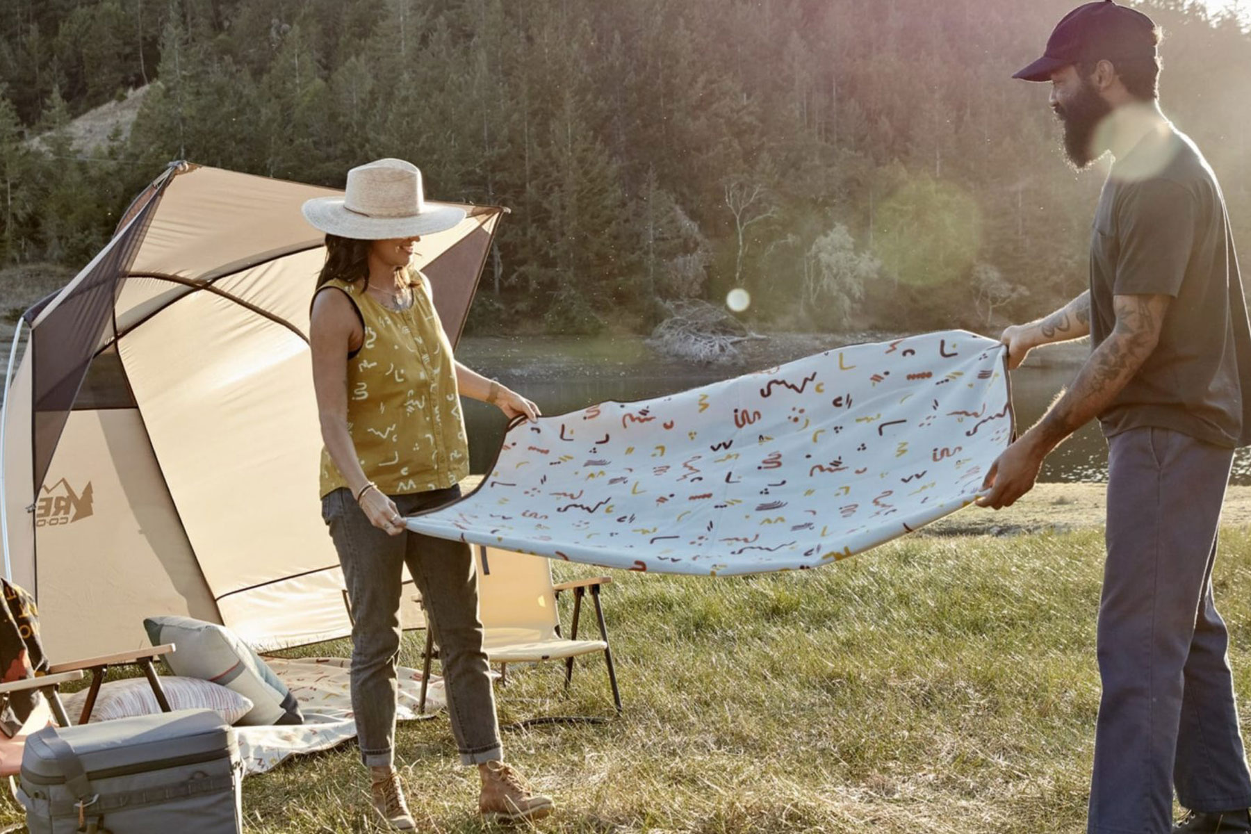 couple sets up outdoor and camping supplies