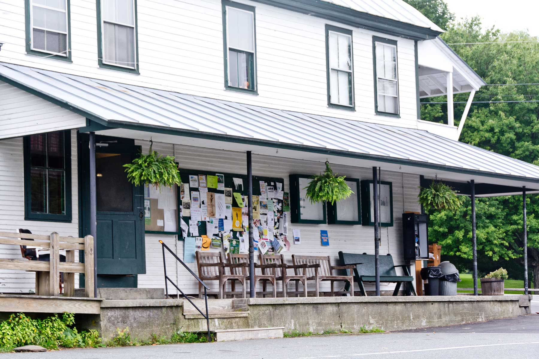 Benches in front of the town bulletin board invite visitors to stay a while and chat on the porch of the Barnard General Store on a summer evening.