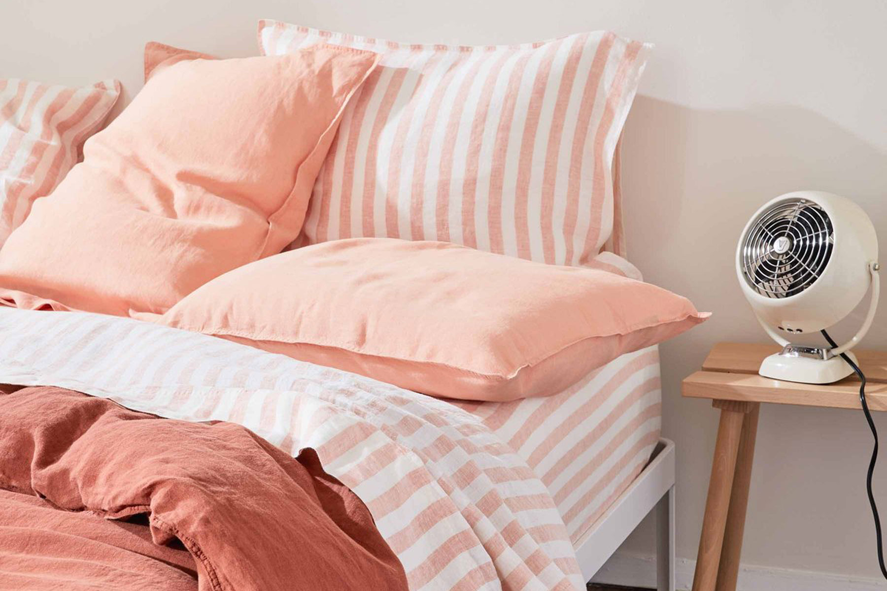 Orange striped linen sheets on bed
