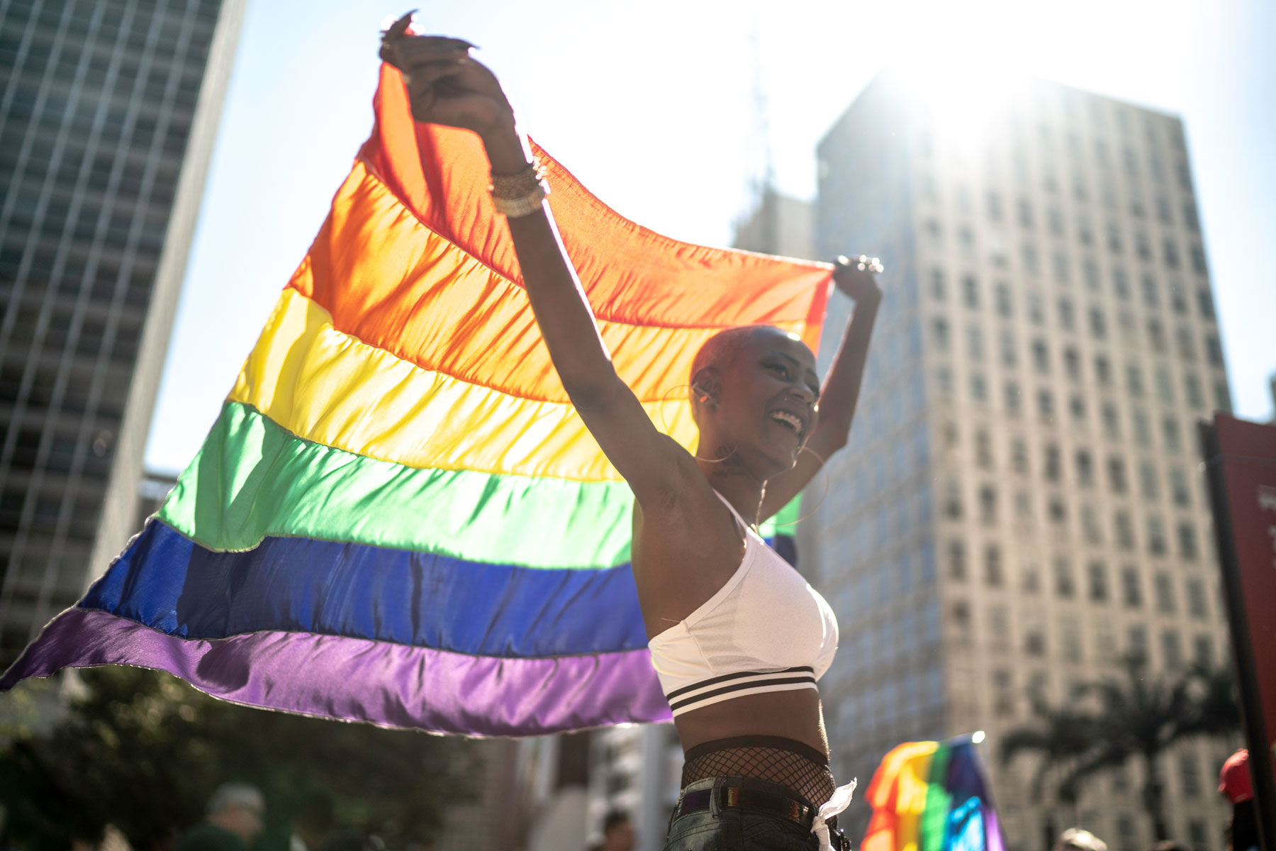 Woman holding pride flag at pride parade