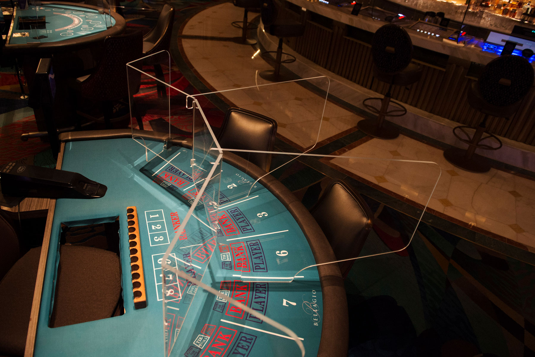 transparent partition at a casino table game