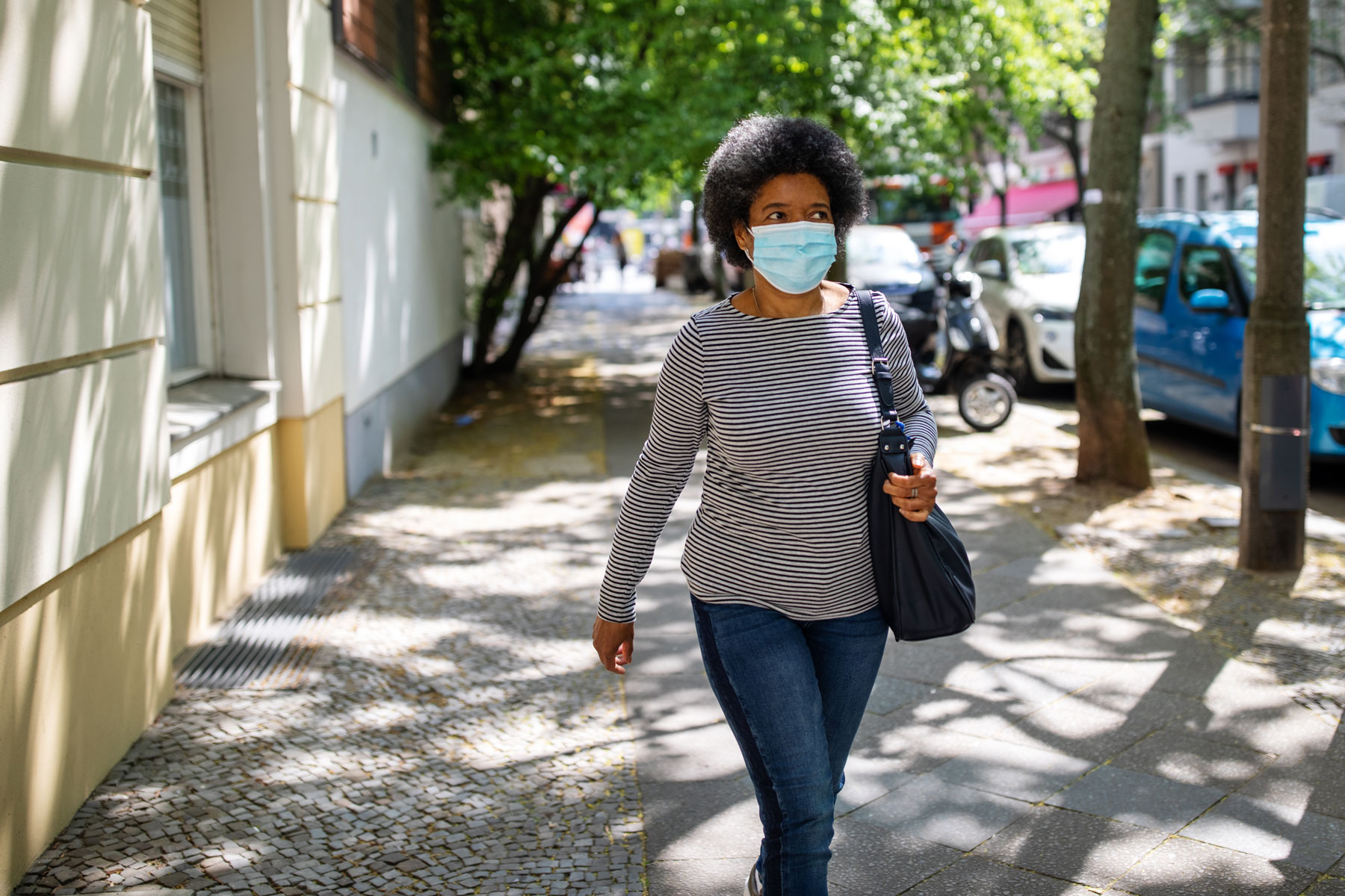 woman wearing face mask while walking outside