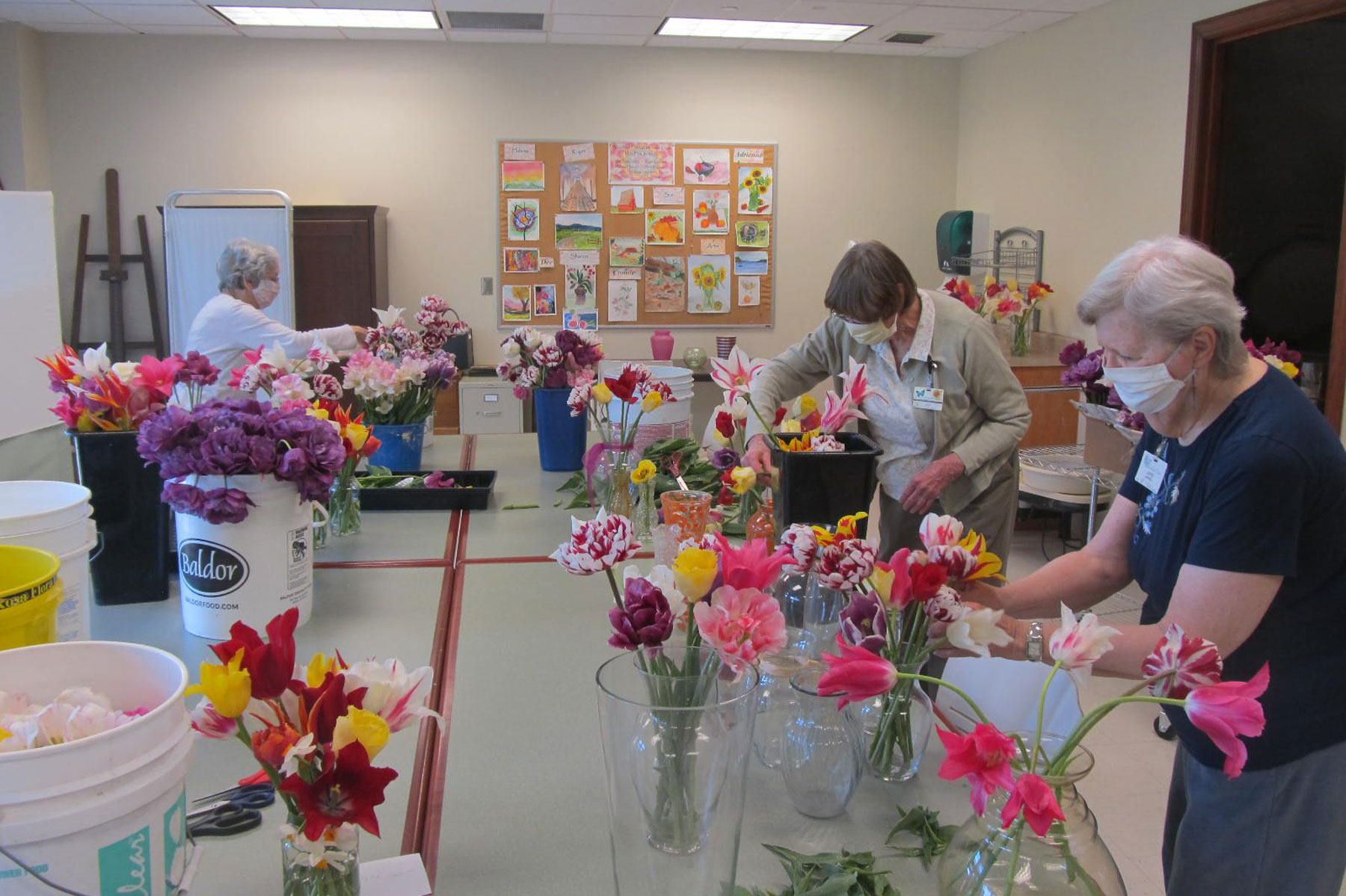 seniors arranging flowers