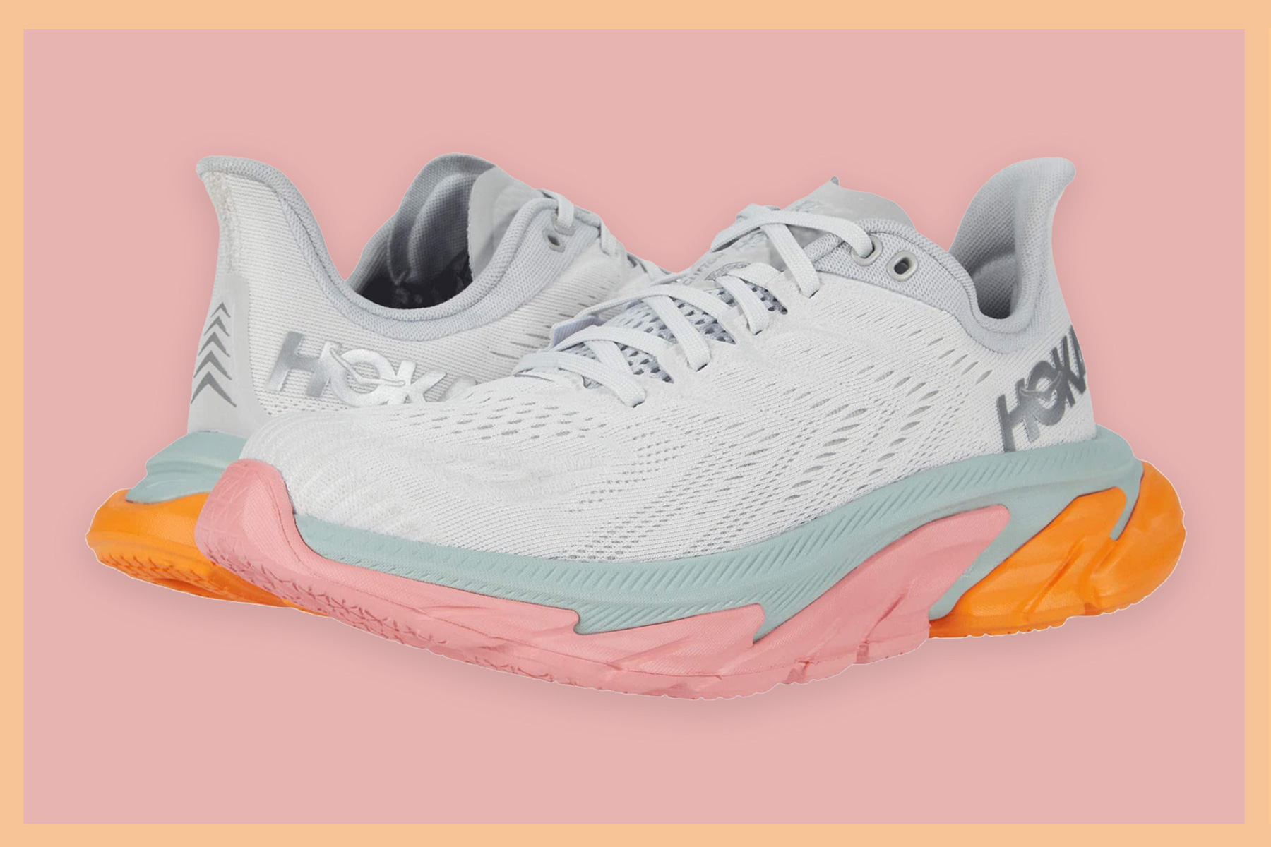 White, pink, and orange running shoes