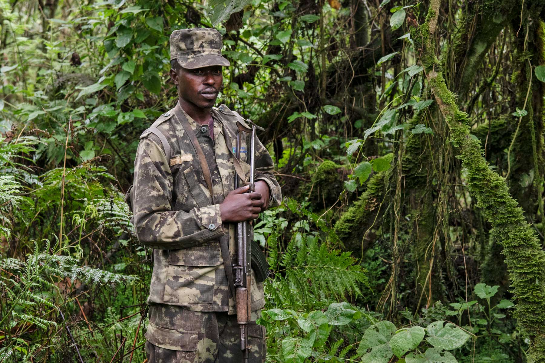 A soldier on anti-poaching patrol in Volcanoes National Park