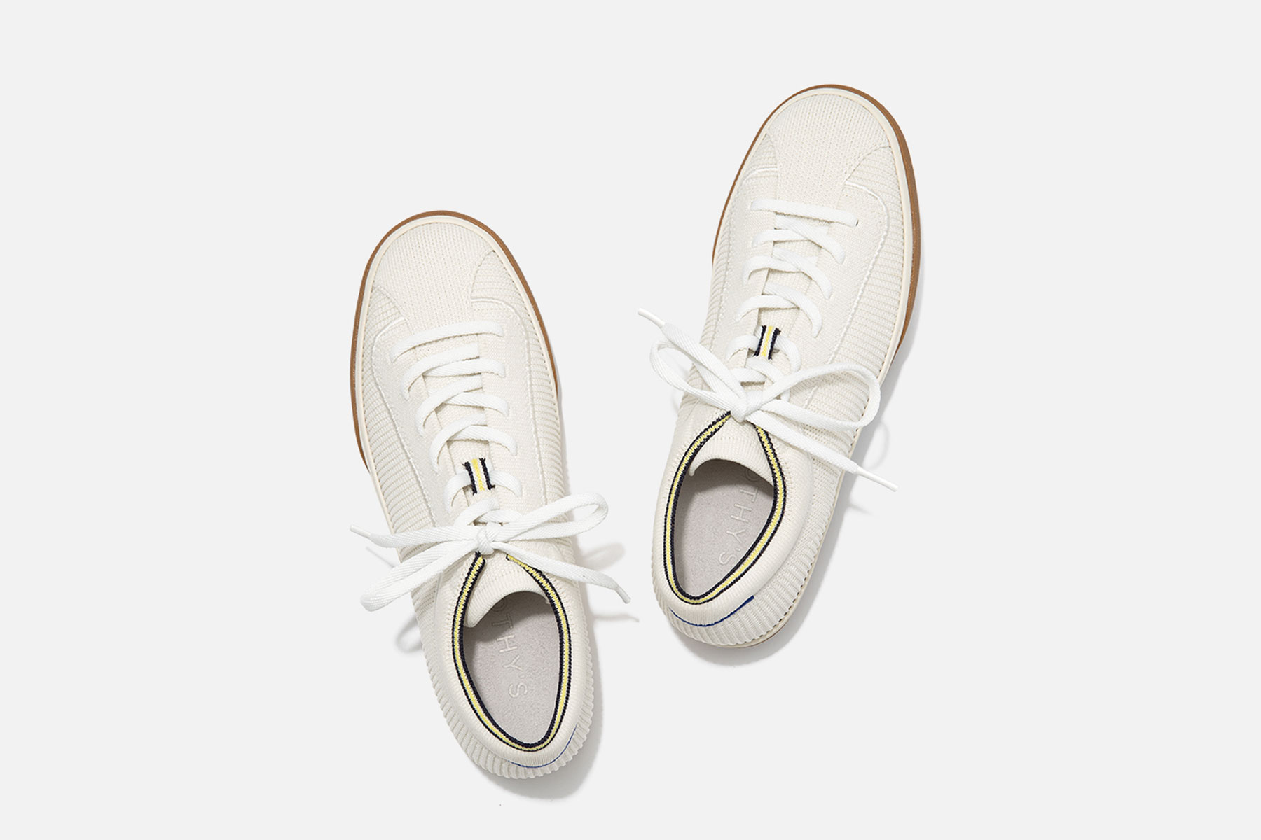 Cream-colored lace up sneakers