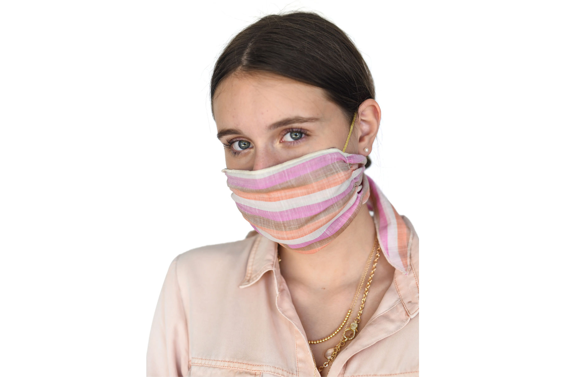 Woman wearing pink striped cloth face mask