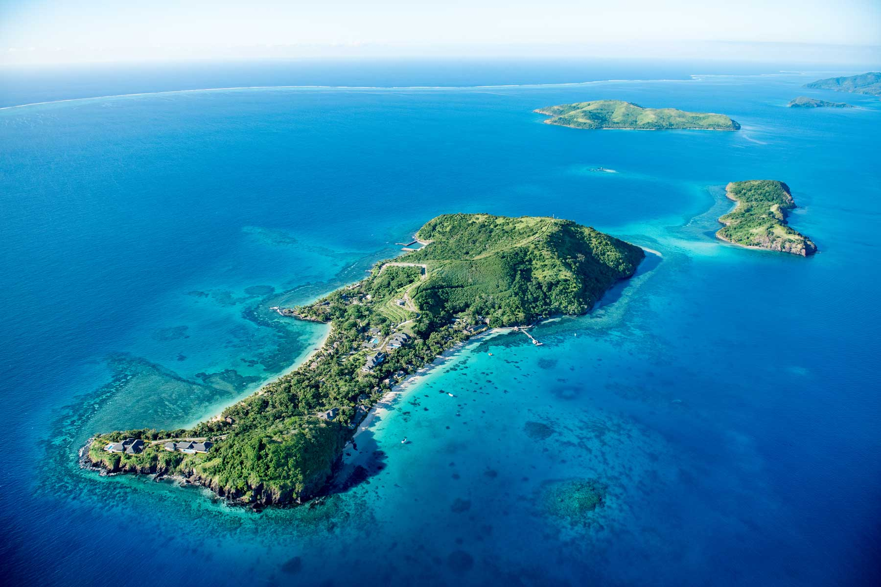 Aerial view Kokomo Private Island Fiji surrounded by blue water