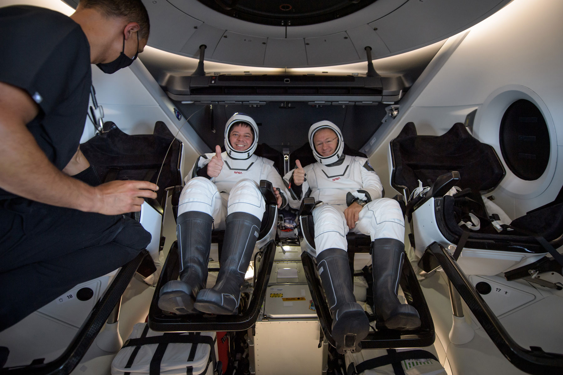 astronauts Bob Behnken and Doug Hurley seated inside SpaceX's Crew Dragon spacecraft